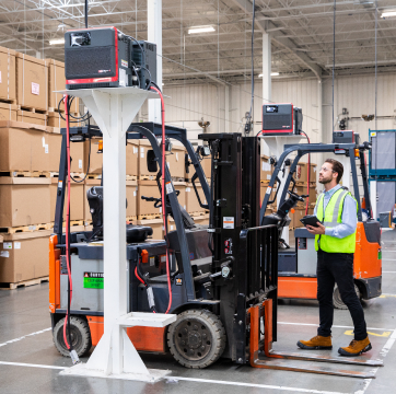 TVA employee inspecting electric forklift