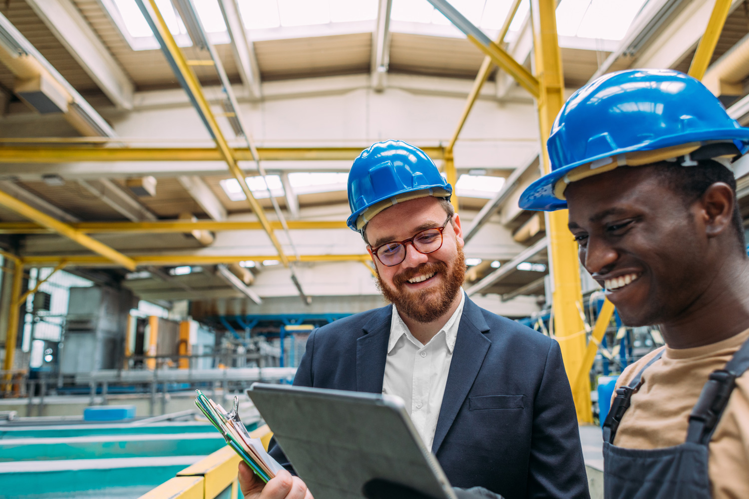 white male and black male in hard hat